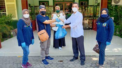 IkaSpenda 2 Surabaya Berbagi Hewan Qurban dan Sodaqoh Dari Alumni untuk Guru